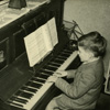 At the piano aged 8